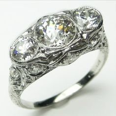 Triple Opulence: This marvelous confection with layer upon layer of exquisite detailing might be the ultimate ornament for your finger. Ca. 1905  Maloys.com