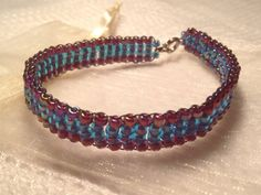 Beaded bracelet - blue and red - handmade from quality Japanese seed beads. Includes cream organza gift bag. on Etsy, $17.50 AUD