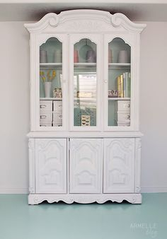Painted hutch. I love the idea of painting the inside background a different color. Or maybe use a fun wallpaper print.