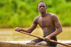 Frans Lanting - Man in canoe, Wechiau, Ghana