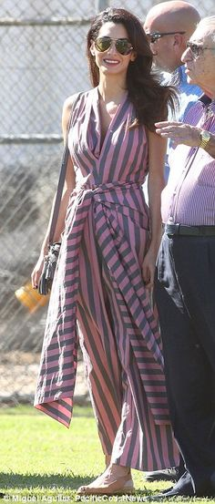 Amal Clooney wears bold striped jumpsuit as she visits George on set with her father | Daily Mail Online
