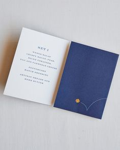 """Navy-and-white trifold menus, accented with gold-foil tennis ball motifs, sat on the bread plates at the reception dinner. The message on the front? """"Dinner is served."""" (They just couldn't resist the pun.) Courses took another witty turn, instead dubbed """"Set 1,"""" """"Set 2,"""" and """"Set 3."""""""