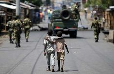 """UN Security Council calls for peaceful solution to Burundian crisis   Boys walk behind patrolling soldiers in Bujumbura, Burundi, May 15, 2015. [Photo/Agencies]  UNITED NATIONS -- The UN Security Council on Friday voiced its """"serious concern"""" at the ongoing tensions and unrest in Burundi, and """"stressed the urgent need for dialogue and reconciliation among all Burundians to resolve the current crisis in a peaceful, transparent and inclusive manner.""""  """"The members of the Security Council…"""