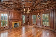 A $11.9 Million Stone Colonial House in Connecticut Has Magnificent Details at Every Turn Photos. The wood-paneled library showcases an elaborately carved ceiling | Architectural Digest
