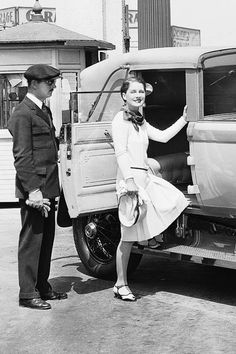 Norma Shearer stepping into her chauffeured car outside MGM studios, 1928.
