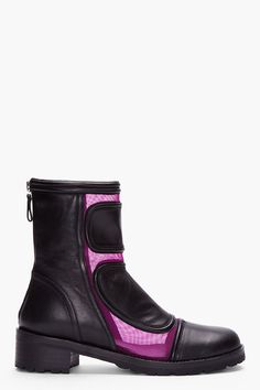 Today's So Shoe Me is the Purple Combo Leather Network Boots by Versus, $880 $264, available at SSENSE. A cool combat shape and a pop of purple mesh create an electro punk style that will mix and match with minimalist separates and edgy grunge looks.