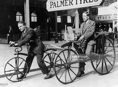15 - Two men (L-R) ride on early bicycles known as the Hobby Horse and 'Boneshaker'. The Hobby Horse was invented by Karl Von Drais in 1818 and was operated by kicking against the street. In 1863, a French coachbuilder added cranks and pedals to the Hobby Horse and invented the 'boneshaker', circa 19th century.