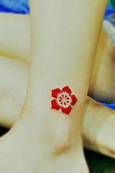 bright red totem flower tattoo on the ankle #flower #tattoo