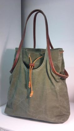 Evon Cassier bags -- repurposes items like firefighter coats and old sport coats into cool totes.
