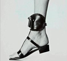 Roger Vivier for Yves Saint Laurent's African Collection, Mask Sandals, photographed by André Ostier, 1967
