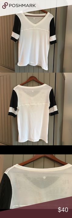lululemon athletica vintage white T-Shirt lululemon athletica vintage white T-Shirt, size 6. Loose fit, some wear on upper back of shirt otherwise in good condition! Perfect tee to wear on football Sundays! lululemon athletica Tops Tees - Short Sleeve