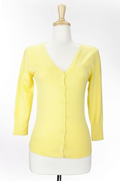 Dressing Your Truth - Type 1 Baby Yellow Cardigan     Take your look up a notch with this lovely cardigan. Soft and light weight.         V Neck      Button Front      3/4 Length Sleeve      80% Acrylic, 18% Nylon, 2% Spandex   buttery...