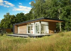 This prefab design looks stunning on a German hillside.Sommerhaus Piu Prefab Vacation Home by German industrial designers Patrick Frey and Björn Götte Cheap Prefab Homes, Modern Prefab Homes, Modular Homes, Prefab Cabins, Prefabricated Houses, Prefab Cottages, Small House Design, Modern House Design, Style At Home