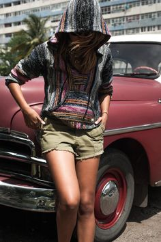 Classic cars, Cuban streets and one festive poncho with fashion blogger, Sincerely Jules.Cruising around town in classic cars Sincerely Jules looks sty...