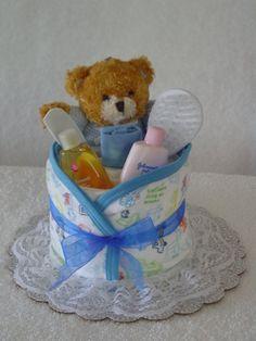 Mini diaper cake with some essentials. :)