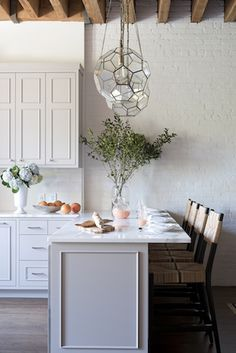 threshold interiors Loft Kitchen in Dove Tale by Farrow & Ball and Arteriors Light Fixtures, stools by Serena & Lily.......