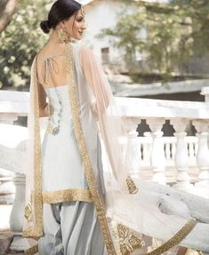 Best 12 Light Grey and Pink Embroidered Punjabi Suit features a dhupioni silk kameez, santoon bottom and embroidered net dupatta. Handwork embellishments are present on this style. Indian Suits Punjabi, Punjabi Suits Party Wear, Punjabi Dress, Indian Attire, Punjabi Salwar Suits, Patiala Suit, Patiala Dress, Phulkari Suit, Indian Wear