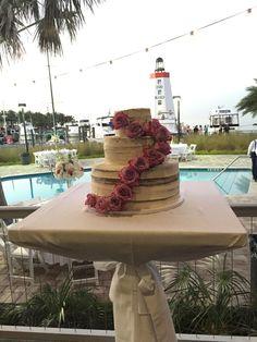 The gorgeous cake with a stunning backdrop! #Lighthouse #WeddingCake #Wedding #Reception #FloridaKeys #FaroBlanco #WeddingVenue #Waterfront #Beautiful