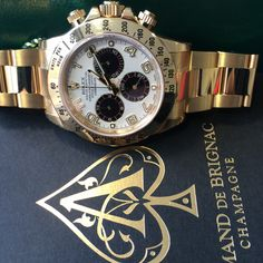 Everything you need for the weekend right there http://www.globalwatchshop.co.uk/rolex-daytona-18ct-yellow-gold-white-panda-dial-116528.html?utm_content=bufferb9485&utm_medium=social&utm_source=pinterest.com&utm_campaign=buffer Daytona & Armand de Brignac