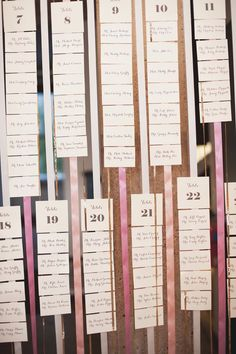 Escort card idea. Could be more useful if arranged by name and have letter headers the way they have table numbers listed here. Or, one letter per ribbon.