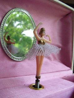 ballerina...I so used to have one of these jewerly boxes when I was a little girl! ah, nostalgia!