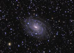 The universe is filled with galaxies. But to see them astronomers must look out beyond the stars of our galaxy, the Milky Way. For example, consider this colorful telescopic view of spiral galaxy NGC 6384, about 80 million light-years away in the direction of the constellation Ophiuchus. At that distance, NGC 6384 spans an estimated 150,000 light-years. The sharp image shows details in the distant galaxy's blue spiral arms and yellowish core.