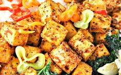 <p>This recipe gives you three incredible dishes that form one epic meal. The tofu is marinated in a spicy, tangy, homemade Cajun spice mix and served with rich, creamy grits and garlicky greens. </p>