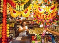 Flowers and incense: A colorful shop to match its colorful, friendly owner. After first posing awkwardly for the photo, we decided to start asking her questions about the incense she was selling and that seem to loosen her up. Head over to our blog to get a glimpse of the Real Mauritius and its beautiful, colorful and friendly people in a stunning and honest photo essay.