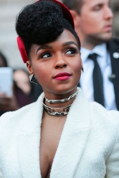 Janelle Monae wearing a Kristina Dragomir hat, an Akris outfit and Jennifer Fisher jewelry after the Akris show during the Paris Fashion Week SS16 on October 4, 2015 in Paris, France.