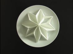 How to Fold a Snowflake Napkin for the Holidays - YouTube