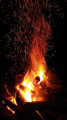 Bonfire with red sparks.