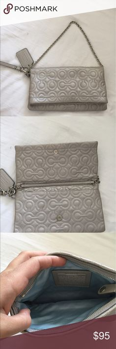 Coach handbag Silver colored coach handbag that can be used as a clutch also. Very adorable and delicate look. Coach Bags Clutches & Wristlets