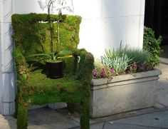 How to make a moss chair.  Scary thing is, I have just the place in my yard where I could put this...I might try a moss bench instead...attatch two or three chairs together...either that or do this wing chair with a little matching foot stool!  Then maybe a little fruit tree or something tall on the side to be like a lamp or shade...hmm...ideas.