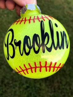 These popular ornaments make the perfect gift or keepsake for your favorite softball enthusiast. Great team gift for end of season parties and they make great gifts for coaches. Order one for each player on the team! 3 plastic disc shaped ornament with bright yellow glitter inside. One