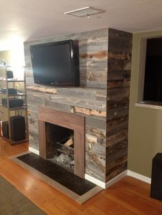 Reclaimed wood fireplace... it would be easy to cover the ugly brick ...