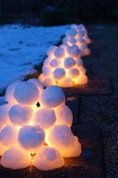 19 Brilliant ideas for Outdoor Christmas decorations: Giant Christmas Lollipops Lights covered with snow balls to make snow lanterns. A perfect outdoor project to lighten up your front porch! These snowball lanterns look really stunning and warm by t