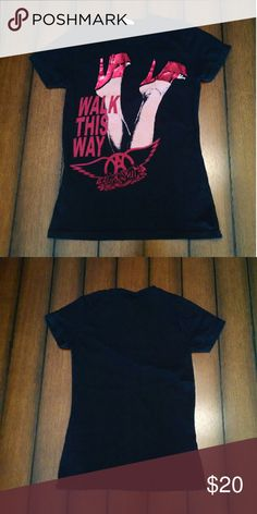 """Aerosmith """"Walk This Way"""" Women's Band Tee Aerosmith band tee with graphic print on the front of red high heels and the words """"Walk This Way"""" with the Aerosmith logo. This tee was only worn and laundered twice and is in great condition. Pair with jeans and boots or some red heels of your own! Perfect for any rock and roll lover! Tops Tees - Short Sleeve"""