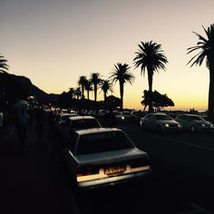 I miss this place so much... Roll on February ... #campsbay #capetown #southafrica #za #westerncape #sunset #palmtree #skyporn #holiday #travel #southernhemisphere #anotherworld #picoftheday #instagram #beach #sky #yellow #iconic #love #2015 #iphone #nofilter #12apostles #ocean #atlantic by flying.jc http://ift.tt/1ijk11S