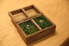 Wooden ring box with moss