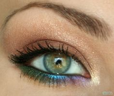 Use a taupe or gold shadow on your lid. Then pick three different eyeliners to use under the eye.