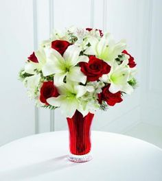 Christmas floral arranging Rose Lily Bouquet by Beyond Blossoms