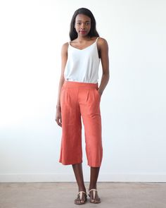 The Emerson pattern is a pull on pant or short with an elasticized back and flattering front waistband that sits just below the natural waist. Both views have front pleats and side pockets. View A ...