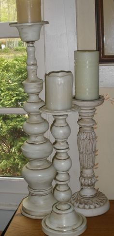 Recycled lamps make nice candle holders.  Spray painted white and then antiqued.