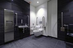 commercial restroom - dark tile floor and wall