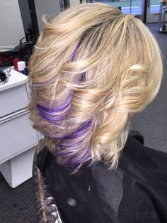 Blonde hair with purple highlights done by the one and only Kara Peters