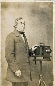 CDV of a photographer using a Daguerreotype style camera.  This image is c1860-1865.