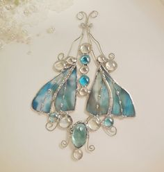 Hey, I found this really awesome Etsy listing at https://www.etsy.com/listing/89343837/raindrop-turquoise-blue-stained-glass