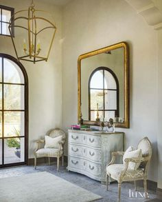 Love this French design. Gorgeous mirror and chandelier.