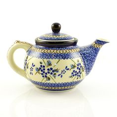 """Beautiful teapot with an 10oz. capacity. Pattern designed and signed by master artist Barbara Fidelus. The artist has been connected with the Artistic Handicraft Cooperative """"Artistic Ceramics and Pottery"""" since 1988. Since 1994 she has been a pattern des"""