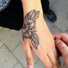 Traditional Flower hand tattoo I would need color but love the way it follows the curves of her hand: